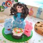 Girl and bunnies cake topper
